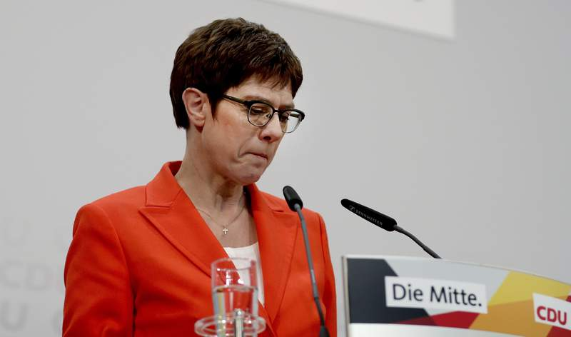 In this Friday, Feb. 7, 2020 photo Annegret Kramp-Karrenbauer, chairwoman of the German Christian Democratic Union (CDU), adresses the media during a press conference at the party's headquarters in Berlin, Germany. Angela Merkel's designated successor will quit her role as head of the Germany's strongest party and won't stand for the chancellorship following a debacle in a regional election. (AP Photo/Michael Sohn)