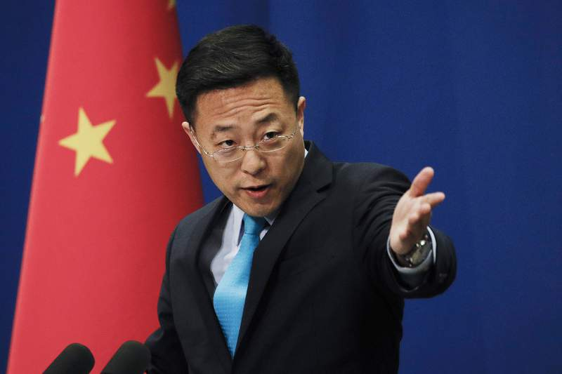 FILE - In this file photo taken Monday, Feb. 24, 2020, Chinese Foreign Ministry spokesperson Zhao Lijian gestures as he speaks during a daily briefing at the Ministry of Foreign Affairs office in Beijing. Zhao on Wednesday, March 17, 2021, said China has protested to the United States and Japan over a joint statement it said maliciously attacked its foreign policy and seriously interfered in Chinas internal affairs. (AP Photo/Andy Wong, File)