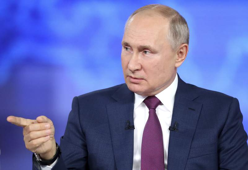 Russian President Vladimir Putin attends his annual live call-in show in Moscow, Russia, Wednesday, June 30, 2021. Speaking in a live call-in program Wednesday, Vladimir Putin has voiced hope that the country could avoid a nationwide lockdown amid a surge of new infections. (Sergei Savostyanov, Sputnik, Kremlin Pool Photo via AP)