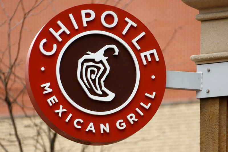 FILE - This Jan. 12, 2017, file photo shows the sign on a Chipotle restaurant in Pittsburgh. Federal prosecutors say Chipotle Mexican Grill has agreed to pay a record $25 million fine to resolve criminal charges that it served tainted food that sickened more than 1,100 people in the U.S. from 2015 to 2018. The fast food company was charged Tuesday, April 21, 2020 in Los Angeles federal court with two counts of violating the Food, Drug, and Cosmetic Act by serving adulterated food. The charges stem from outbreaks of norovirus, which causes diarrhea, at some Chipotle restaurants other than this location. (AP Photo/Gene J. Puskar, File)