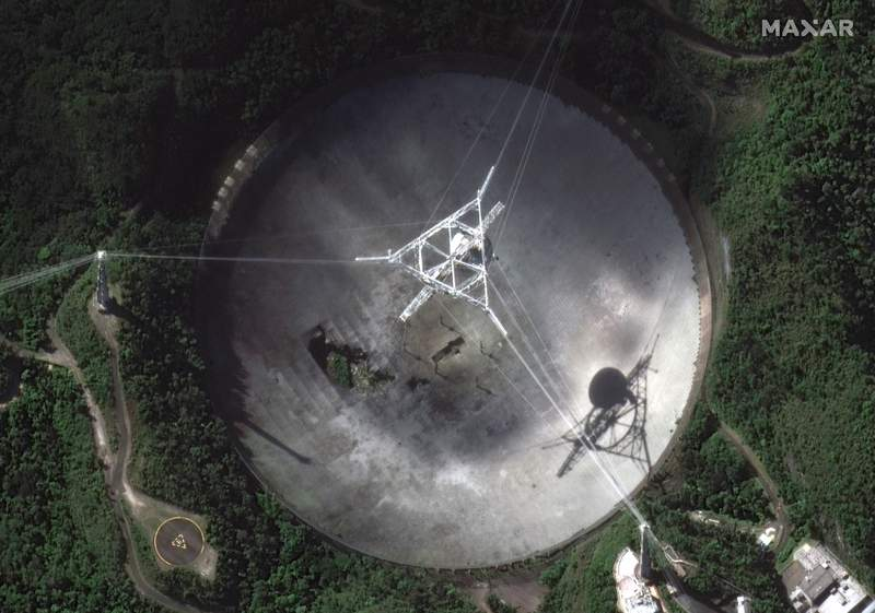 This satellite image provided by 2020 Maxar Technologies shows the damaged radio telescope at the Arecibo Observatory in Puerto Rico, Thursday, Nov. 17, 2020. The National Science Foundation announced Thursday, Nov. 17 that it will close the huge telescope in a blow to scientists worldwide who depend on it to search for planets, asteroids and extraterrestrial life, saying its too dangerous to keep operating the single-dish radio telescope because the entire structure could collapse. (Satellite image 2020 Maxar Technologies via AP)
