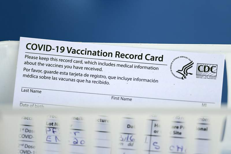 A vaccination record card is shown during a COVID-19 vaccination drive for Spring Branch Independent School District education workers Tuesday, March 16, 2021, in Houston. (AP Photo/David J. Phillip)
