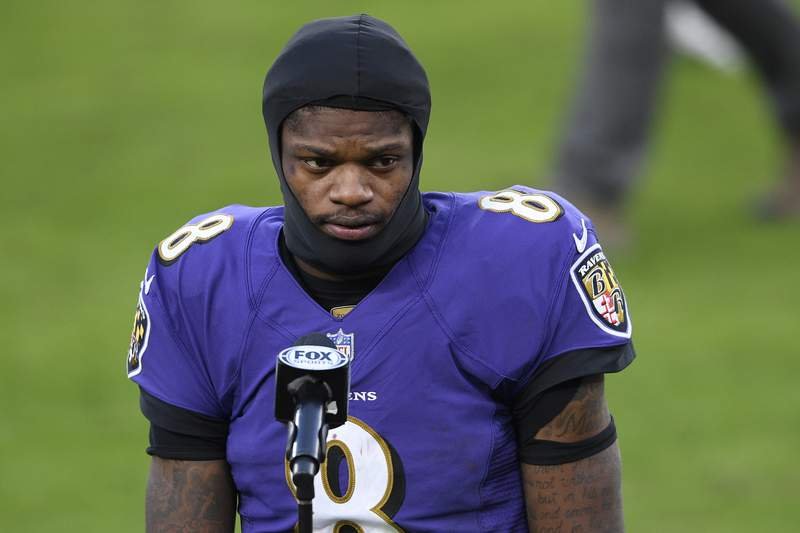 FILE - Baltimore Ravens quarterback Lamar Jackson (8) stands on the field after an NFL football game against the New York Giants in Baltimore, in this Sunday, Dec. 27, 2020, file photo. Lamar Jackson was not practicing with the Baltimore Ravens at the start of their first practice of training camp Wednesday, July 28, 2021. (AP Photo/Nick Wass, File)