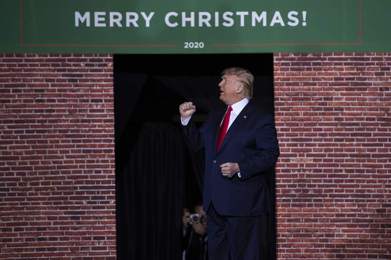 FILE - In this Dec. 18, 2019, file photo, President Donald Trump speaks during a campaign rally at Kellogg Arena in Battle Creek, Mich. From foreign policy initiatives to the choice of music at White House events, from the prevalence of Merry Christmas greetings to the title of the new USMCA trade deal, Trump is happy to give himself a public pat on the back _ repeatedly _ for his great ideas. (AP Photo/ Evan Vucci, File)
