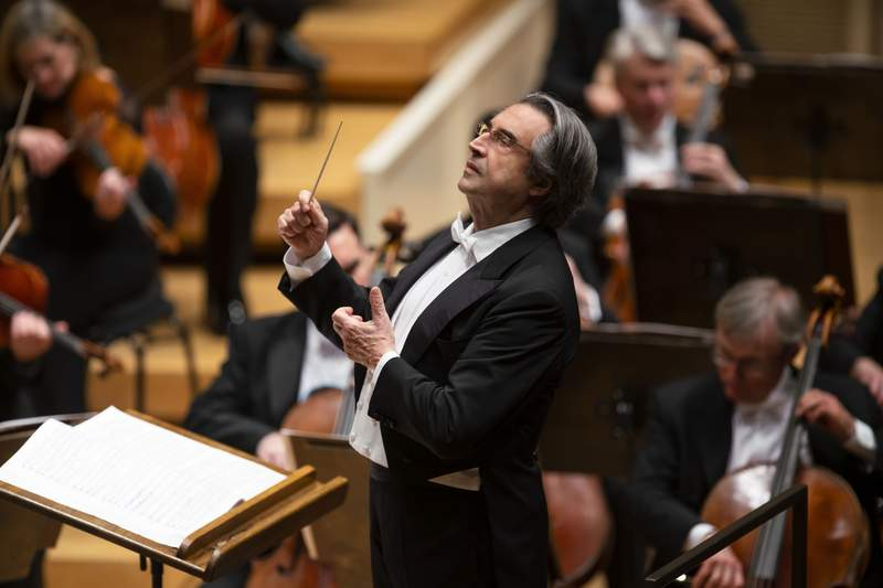 This image released by Chicago Symphony Orchestra shows music director Riccardo Muti conducting the Chicago Symphony Orchestra on May 9, 2019 in Chicago. Muti has extended his contract as music director of the Chicago Symphony Orchestra by one year through the 2022-23 season. The 80-year-old Italian became music director of the CSO in 2010, succeeding Daniel Barenboim. (Todd Rosenberg/Chicago Symphony Orchestra via AP)