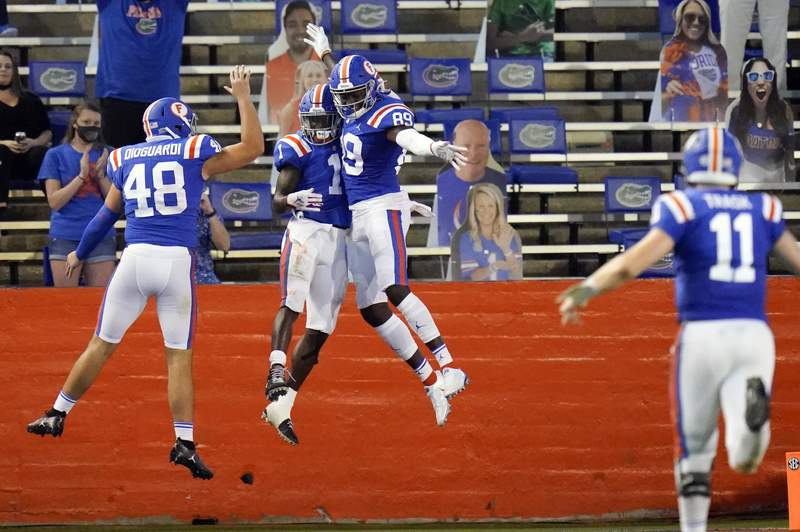 Florida wide receiver Kadarius Toney, center left, celebrates his touchdown against Missouri on a pass from quarterback Kyle Trask (11), with Brett DioGuardi (48) and Justin Shorter (89) during the first half of an NCAA college football game, Saturday, Oct. 31, 2020, in Gainesville, Fla. (AP Photo/John Raoux)