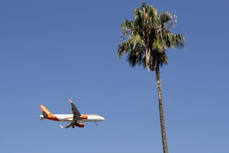 FILE - In this Aug. 21, 2019 file photo, an easyJet airplane approaches Lisbon airport for landing. Leaders from Britain's aviation industry joined forces Wednesday April 14, 2021, to urge the British government to ensure that popular European destinations face the least onerous coronavirus travel restrictions when holidays are allowed again. (AP Photo/Armando Franca, File)