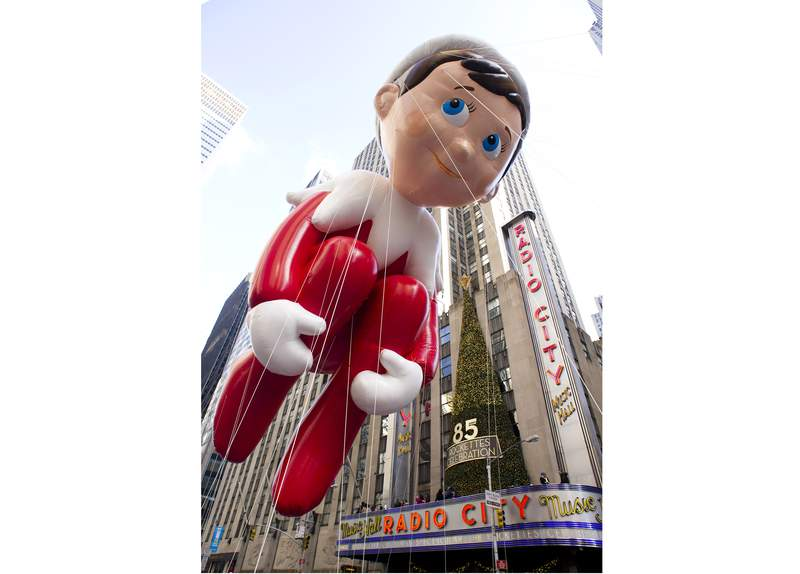 FILE - The Elf on the Shelf balloon floats in the Macy's Thanksgiving Day Parade in New York in New York on Nov. 22, 2012. The pandemic may have upended most traditions this holiday season but the annual New York City parade will still march on with balloons, dancers, floats, Broadway shows and Santa  albeit this time heavily tweaked for safety. (AP Photo/Charles Sykes, File)