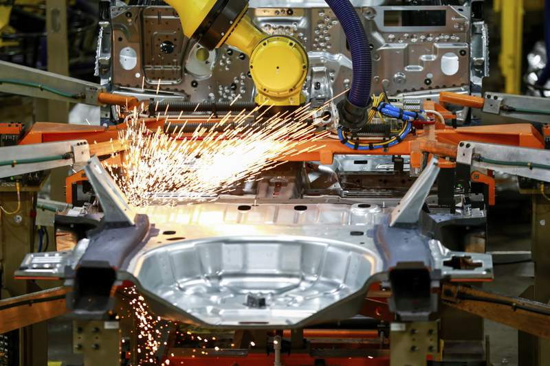FILE - In this June 24, 2019, file photo machines work on a Ford vehicle assembly line at Ford's Chicago Assembly Plant in Chicago.  American factories expanded at a faster pace last month, continuing a rebound from the coronavirus recession. The Institute for Supply Management, an association of purchasing managers, reported Tuesday, Sept. 1, 2020,  that its manufacturing index climbed to 56 in August from 54.2 in July. (AP Photo/Amr Alfiky, File)