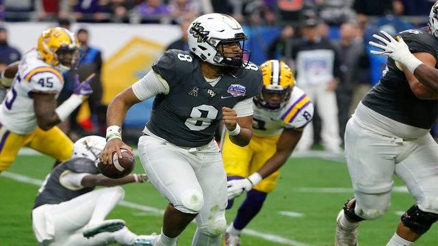 UCF quarterback Darriel Mack Jr. (8) runs away from pressure by the LSU defense during the first half of the Fiesta Bowl NCAA college football game, Tuesday, Jan. 1, 2019, in Glendale, AZ. (AP Photo/Rick Scuteri)