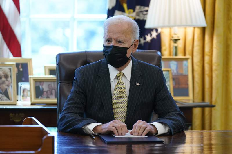 In this March 30, 2021, President Joe Biden speaks after signing the PPP Extension Act of 2021, in the Oval Office of the White House in Washington. Biden wants $2 trillion to reengineer Americas infrastructure and expects the nations corporations to pay for it. (AP Photo/Evan Vucci)