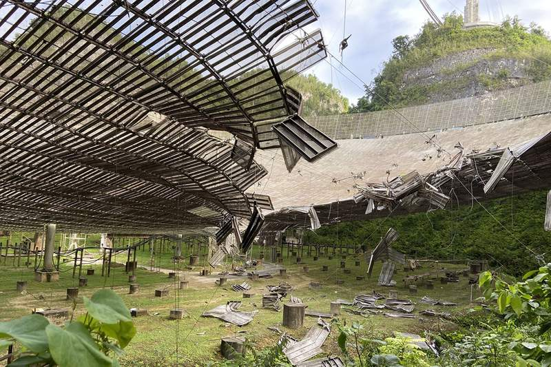 Damage to the Arecibo Observatory collecting dish. (Image: UCF)