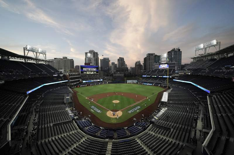 FILE - In this Oct. 6, 2020, file photo, the Tampa Bay Rays and the New York Yankees play in Game 2 of a baseball AL Division Series in an empty Petco Park in San Diego. Major League Baseball and all 30 of its teams are suing their insurance providers, citing billions of dollars in losses during the 2020 season played almost entirely without fans due to the coronavirus pandemic. The suit, filed in October in California Superior Court in Alameda County, was obtained Friday, Dec. 4, by The Associated Press. It says providers AIG, Factory Mutual and Interstate Fire and Casualty Company have refused to pay claims made by MLB despite the league's all-risk policy purchases. (AP Photo/Jae C. Hong, File)