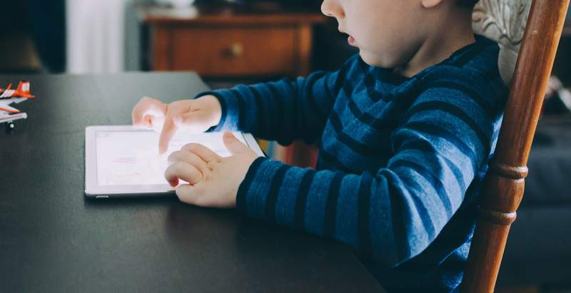 Child playing on tablet.