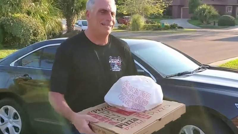 Volusia Sheriff Mike Chitwood delivers pizza