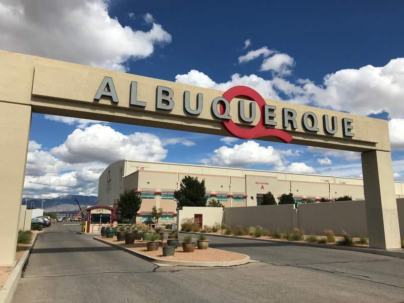 FILE - In this Oct. 8, 2018, file photo, is the entrance to ABQ Studios in Albuquerque, N.M., where Netflix announced at the studio complex that it chose Albuquerque as a new production hub. Netflix is pledging an additional $1 billion investment in its production hub in New Mexico. The company joined government officials Monday, Nov. 23, 2020, in announcing its plans. The expansion will add about 300 acres to the existing campus on the southern edge of Albuquerque, making it what officials say will be one of the largest film production facilities in North America. (AP Photo/Susan Montoya Bryan, File)