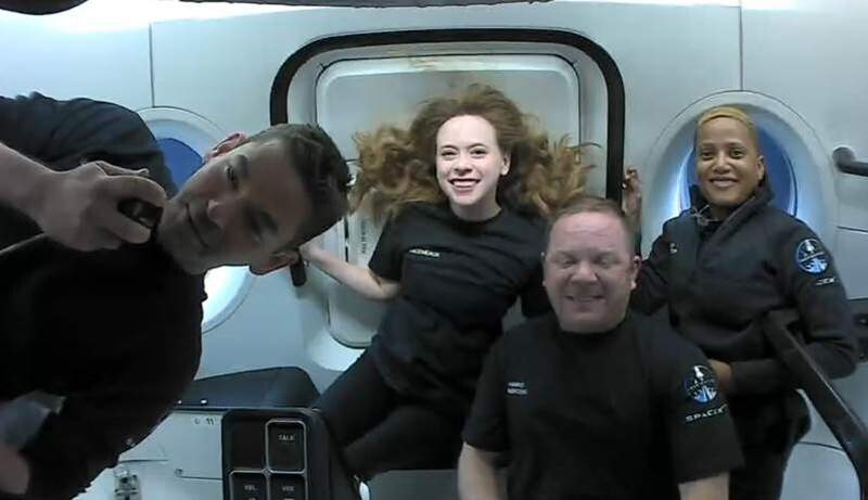This photo provided by SpaceX shows the passengers of Inspiration4 in the Dragon capsule on their first day in space. They are, from left, Jared Isaacman, Hayley Arceneaux, Chris Sembroski and Sian Proctor.   SpaceX got them into a 363-mile (585-kilometer) orbit following Wednesday nights launch from NASA's Kennedy Space Center. That's 100 miles (160 kilometers) higher than the International Space Station.  (SpaceX via AP)