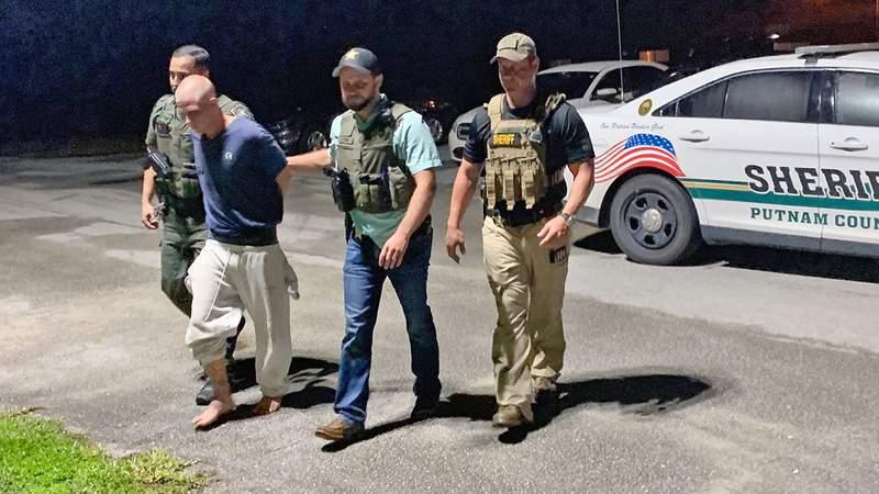 Putnam County deputies take Mark Wilson Jr. to jail late Thursday night.