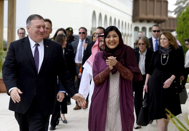 """FILE - In this Feb. 20, 2020, file photo, U.S. Secretary of State Mike Pompeo, left, walks with Saudi ambassador to the United States Princess Reema Bint Bandar at Princess Reema's Palace in Riyadh. With Joe Biden re-emerging as the front-runner in the Democratic presidential race, Saudi Arabia's ambassador to the United States dismisses Biden's description of the kingdom as a """"pariah."""" Ambassador Princess Reema bint Bandar Al Saud said in an interview with The Associated Press recent presidents have always carried on a good relationship between the two countries after taking office. (Andrew Caballero-Reynolds/Pool Photo via AP, File)"""