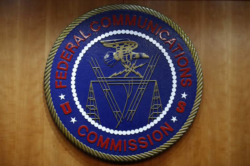 FILE - In this Dec. 14, 2017, file photo, the seal of the Federal Communications Commission (FCC) is seen before an FCC meeting to vote on net neutrality in Washington. The Senate has narrowly approved President Donald Trumps lame-duck nominee, Nathan Simington, on Tuesday, Dec. 8, 2020, to become a member of the Federal Communications Commission. (AP Photo/Jacquelyn Martin, File)