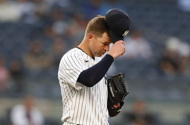 New York Yankees starting pitcher Corey Kluber (28) reacts after giving up a home run against the Toronto Blue Jays during the third inning of a baseball game Tuesday, May 25, 2021, in New York. (AP Photo/Noah K. Murray)