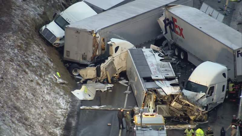FILE  This Sunday, Jan. 5, 2020 image from video provided by KDKA TV shows the scene near Greensburg, Pa. along the Pennsylvania Turnpike where five people were killed and dozens were injured in the crash that involved multiple vehicles. A preliminary report released by the National Transit Safety Board Thursday, Feb. 6, 2020, said all aspects of the crash remain under investigation. (KDKA TV via AP)