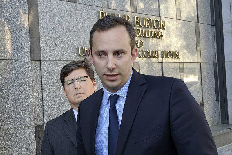 FILE - This Sept. 24, 2019 photo shows former Google engineer Anthony Levandowski, right, in front of his attorney, Miles Ehrlich, outside of a federal courthouse in San Francisco.  President Donald Trump has pardoned Levandowski, who plead guilty to stealing trade secrets before joining Ubers effort to build robotic vehicles for its ride-hailing service. Levandowski was among the more than 140 people included in a flurry of clemency action in the final hours of Trumps White House term.   (AP Photo/Michael Liedtke)