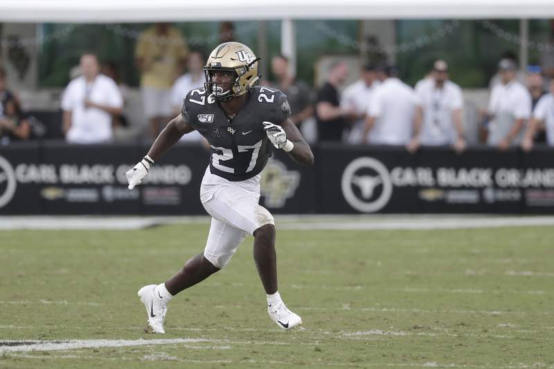 Central Florida defensive back Richie Grant covers a Stanford play during the second half of an NCAA college football game, Saturday, Sept. 14, 2019, in Orlando, Fla. (AP Photo/John Raoux)