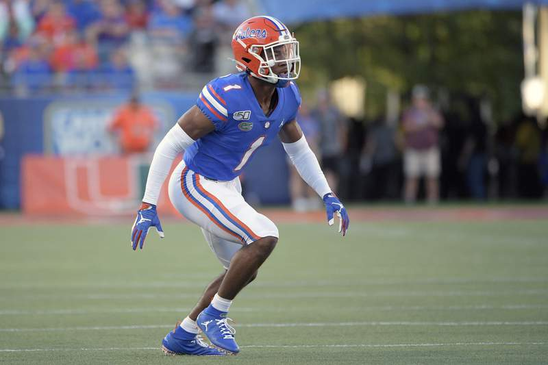 FILE - In this Aug. 24, 2019, file photo, Florida defensive back CJ Henderson (1) follows a play during the first half of an NCAA college football game against Miami in Orlando, Fla. The two biggest losses in free agency for the Dallas Cowboys were at cornerback and defensive end, so it's reasonable to list those as the club's top two priorities going into the draft.(AP Photo/Phelan M. Ebenhack, File)
