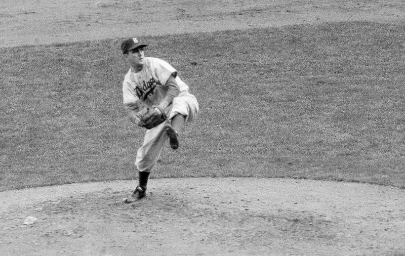 """FILE - In this October 1952 file photo, Brooklyn Dodgers' Carl Erskine pitches against the New York Yankees in Game 5 of the baseball World Series in New York. Up by 13 1/2 games in mid-August in 1951, Jackie Robinson and the Dodgers seemed destined. That was until rookie Willie Mays and the New York Giants came flying back, fueled by an incredible, late run in home games at the Polo Grounds, and forced a best-of-three playoff for the National League pennant. Erskine was warming up in the Brooklyn bullpen in Game 3 when Bobby Thomson connected for the famed """"Shot Heard 'Round the World,"""" a three-run homer in the bottom of the ninth off Ralph Branca that rallied the Giants to a 5-4 win. A half-century later, a giant secret was revealed: The Giants had rigged a spyglass-and-buzzer system in late July to steal catchers' signals and tip off their hitters. (AP Photo, File)"""