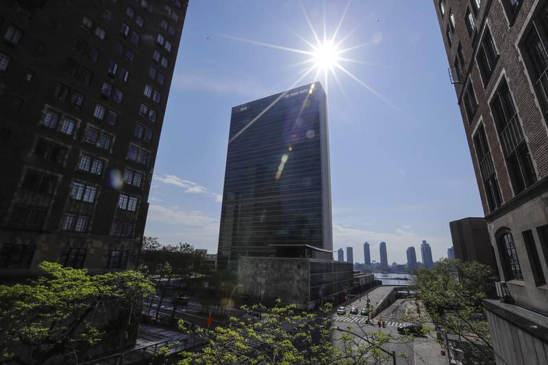 Sparse traffic due to coronavirus, moves past the United Nations headquarters Friday, May 15, 2020, New York. (AP Photo/Frank Franklin II)