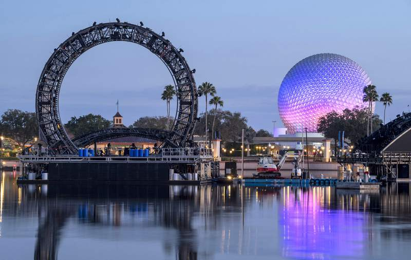 """An iconic six-story tall central ring structure to be the centerpiece of """"Harmonious,"""" the new nighttime spectacular coming to EPCOT, moves into position to begin testing on the theme park's World Showcase Lagoon, Feb. 27, 2021, at Walt Disney World Resort"""