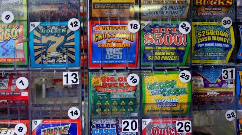 In this Thursday, July 17, 2014 photo, scratch-off lottery tickets for sale are on display at Eagles Express in Knightdale, N.C. North Carolina's lottery has steadily grown over its first decade and its leaders say it has room to grow even more in the coming years. (AP Photo/Gerry Broome)