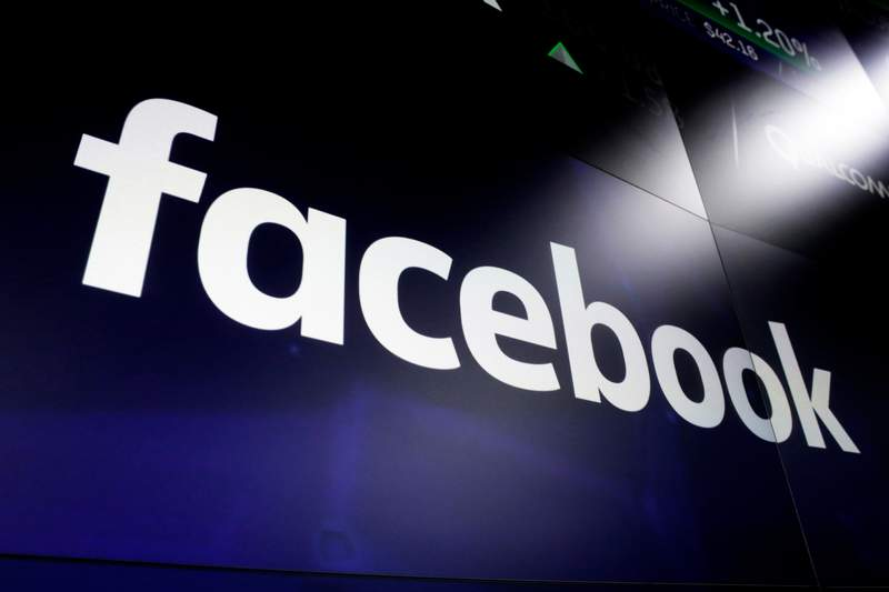 FILE - This March 29, 2018, file photo shows the Facebook logo on screens at the Nasdaq MarketSite in New York's Times Square. Facebook has removed nearly 200 social media accounts linked to white supremacy groups that planned to encourage members to attend protests over police killings of black people  in some cases with weapons, company officials said Friday, June 5, 2020. (AP Photo/Richard Drew, File)