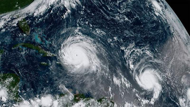What's the process behind naming tropical storms and hurricanes?