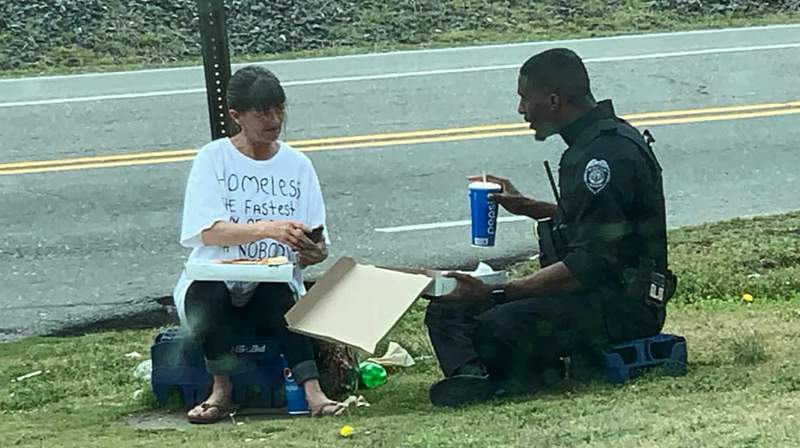 Officer Michael Rivers of the Goldsboro Police Department shared a moment of compassion with a person in need.