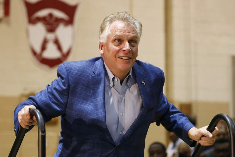 FILE - In this March 1, 2020, file photo, former Virginia Gov. Terry McAuliffe walks up to the stage as he prepares to introduce Democratic presidential candidate and former Vice President Joe Biden during a campaign rally in Norfolk, Va. McAuliffe is trying to get his old job back and is set to announce a formal bid for governor Wednesday, Dec. 9, 2020, in Richmond, according to a McAuliffe aide who was not authorized to speak publicly about the campaign. (AP Photo/Steve Helber, File)