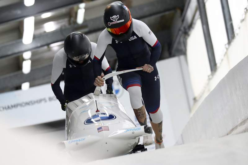 FILE - In this Feb. 5, 2021, file photo, Kaillie Humphries and Lolo Jones, of the United States, start during the two-women's bobsled race at the Bobsled and Skeleton World Championships in Altenberg, Germany.  Reigning womens world bobsled champion and three-time Olympic medalist Humphries has asked the International Olympic Committee for a solution that would allow her to compete in this winters Beijing Games even though her American citizenship will not be finalized. (AP Photo/Matthias Schrader, File)