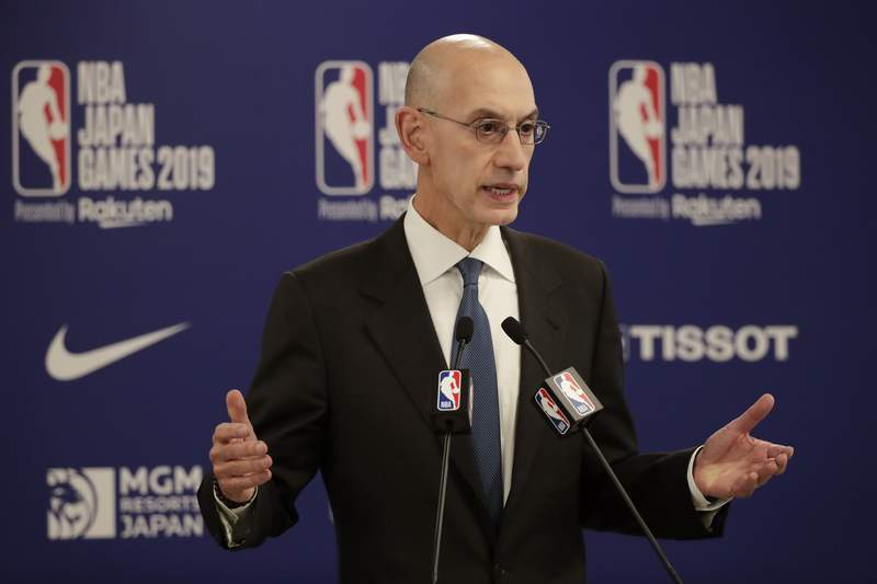 FILE - In this Oct. 8, 2019, file photo, NBA Commissioner Adam Silver speaks at a news conference before an NBA preseason basketball game between the Houston Rockets and the Toronto Raptors in Saitama, near Tokyo. Its been over three months since the commissioners of major sports cancelled or postponed events because of the coronavirus. Enough time for us to grade them on how theyve handled the virus so far. (AP Photo/Jae C. Hong, File)