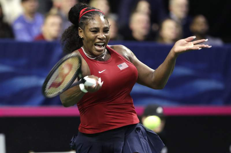 FILE - In this Feb. 7, 2020, file photo, United States' Serena Williams returns a shot to Latvia's Jelena Ostapenko during a Fed Cup qualifying tennis match in Everett, Wash. Williams is planning to make her return to competition at a new hard-court tournament in Kentucky next month. Itll be Williams' first action since playing for the U.S. in the Fed Cup in February, before all sanctioned tennis was shut down the next month because of the coronavirus pandemic. (AP Photo/Elaine Thompson, File)