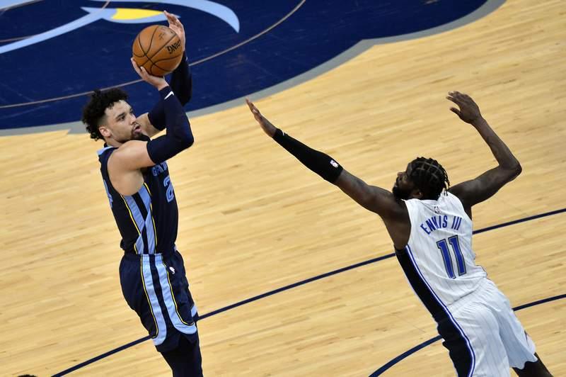 Memphis Grizzlies forward Dillon Brooks (24) shoots against Orlando Magic forward James Ennis III (11) during the second half of an NBA basketball game Friday, April 30, 2021, in Memphis, Tenn. (AP Photo/Brandon Dill)