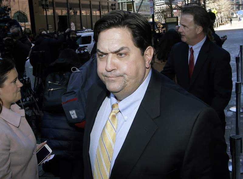 FILE In this March 25, 2019 file photo, William Ferguson, former Wake Forest volleyball coach, arrives at federal court in Boston, to face charges in a nationwide college admissions bribery scandal. Federal prosecutors have promised to drop their case against Ferguson if he pays a $50,000 fine and follows certain conditions, according to court documents unsealed Tuesday, Oct. 12, 2021. (AP Photo/Steven Senne, File)