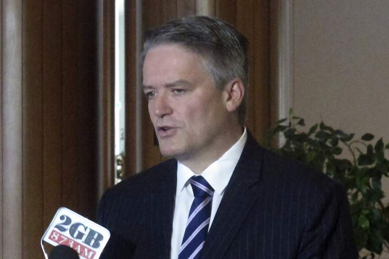 FILE - In this Aug. 8, 2017, file photo, Australian Finance Minister Mathias Cormann addresses reporters at Parliament House in Canberra, Australia. The Organisation for Economic Co-operation and Development, the OECD, said Monday it has appointed Australian former Finance Minister Mathias Cormann as its head - despite objections over his climate record. (AP Photo/Rod McGuirk, File)