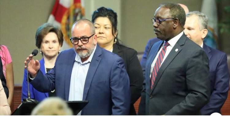 Dr. Raul Pino alongside Orange County Mayor Jerry Demings.