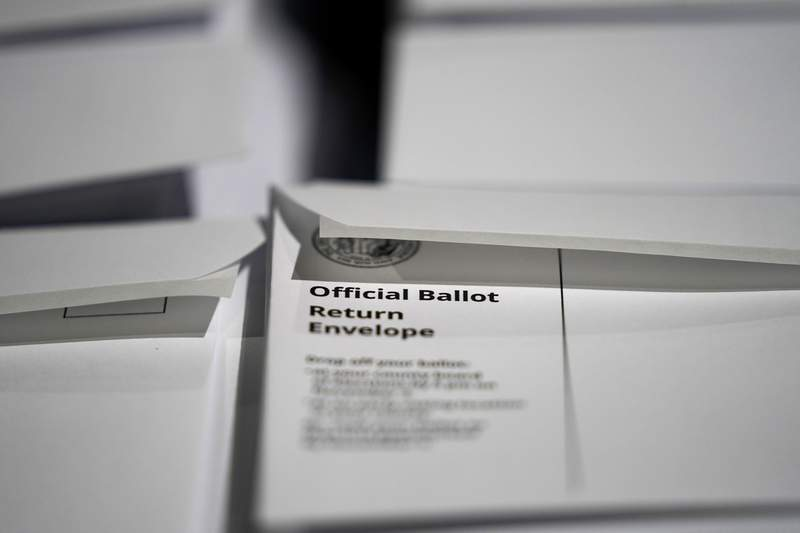 Stacks of ballot envelopes waiting to be mailed are seen at the Wake County Board of Elections in Raleigh, N.C., Thursday, Sept. 3, 2020. North Carolina is scheduled to begin sending out more than 600,000 requested absentee ballots to voters on Friday. (AP Photo/Gerry Broome)