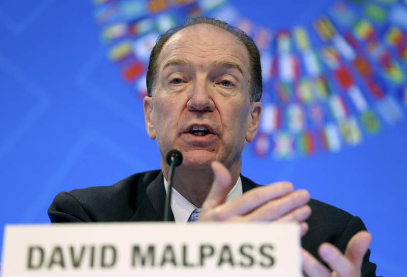 FILE - In this Oct. 17, 2019 file photo, World Bank President David Malpass speaks during a news conference at the World Bank/IMF Annual Meetings in Washington.  The World Bank on Tuesday, Jan. 5, 2021 forecast that the global economy will see a subdued recovery this year from a devastating pandemic but warned that the near-term outlook is highly uncertain and growth could be harmed if infections keep rising and the rollout of vaccines is delayed.(AP Photo/Jose Luis Magana, File)