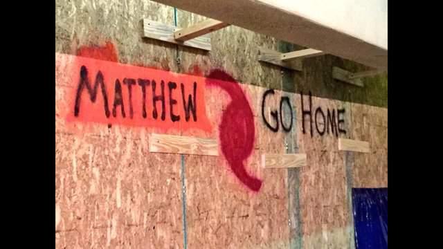 "A Brevard County board reads ""Matthew Go Home."""