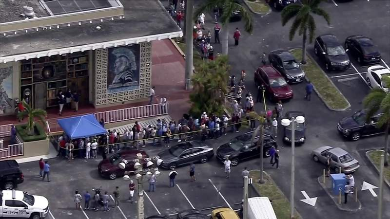 Long lines for food distribution, unemployment forms show how fear and desperation are growing in South Florida