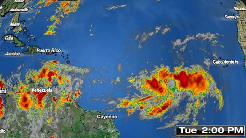 2 systems swirl in tropics