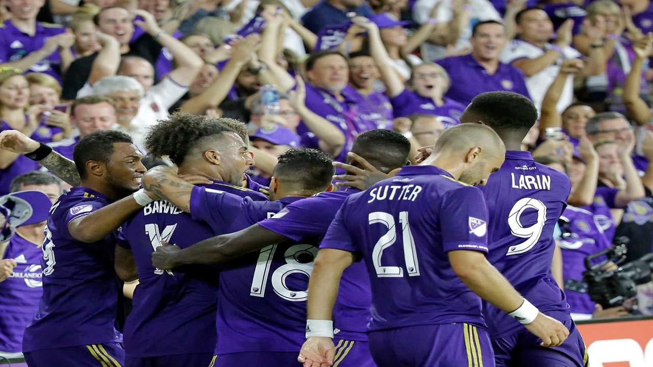 FILE PHOTO: Orlando City's Giles Barnes, second from left, celebrates after scoring a goal with teammates, including Dom Dwyer, Scott Sutter and Cyle Larin, during the second half of the match against Columbus Crew, Saturday, Aug. 19, 2017.